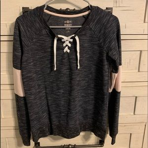 Great condition black with pink stripe sweater